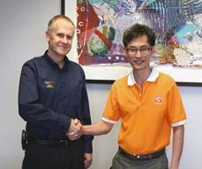 Randy Freeman, QuadTech Vice President and General Manager of Packaging (left) and Noppadol Krairiksh, Managing Director of  C.G.S. Thailand
